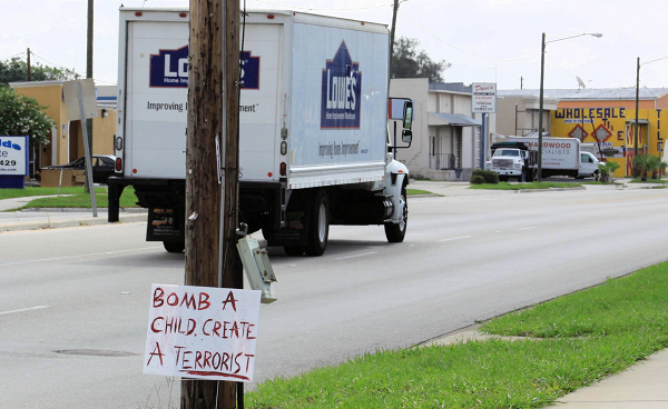 Bomb a child create a terrorist. Signs & banners seen in the Tampa Bay area Memorial Day 2009