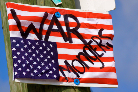 War mongers. Signs & banners seen in the Tampa Bay area Memorial Day 2009