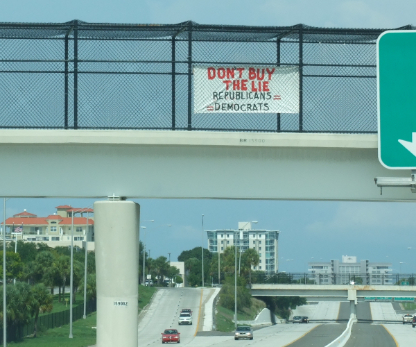 Don't buy the lie - Republicans equal Democrats. Signs & banners seen in the Tampa Bay area Memorial Day 2009