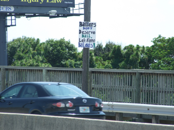 Bankers don't deserve bail, let alone bailouts. Signs & banners seen in the Tampa Bay area Memorial Day 2009
